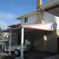 Aluminum awning installed over car port in London, ON