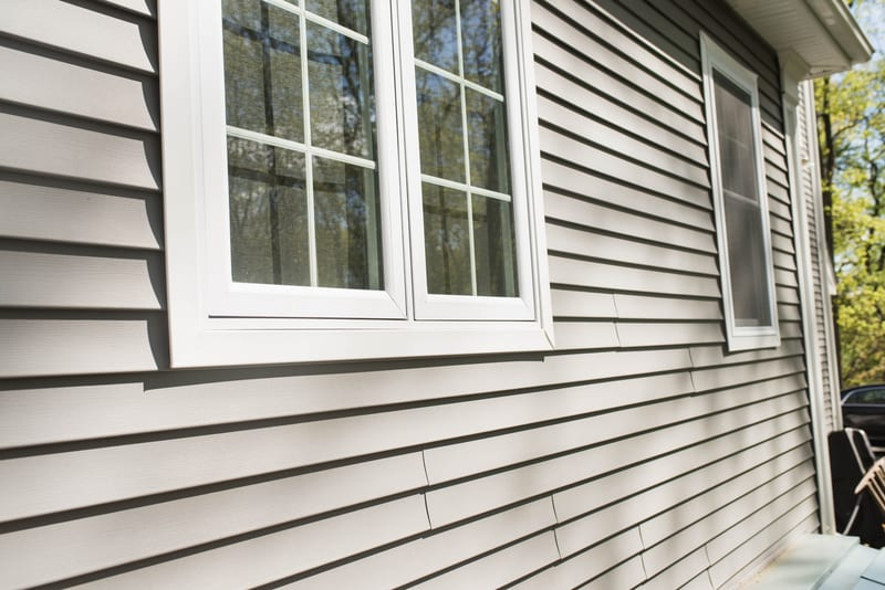 Newly applied Vinyl Siding added to home
